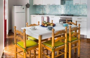 Turquoise kitchen with table and chairs