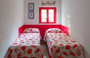 Twin beds with red drawings