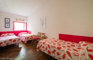 Triple bedroom with red sea drawings