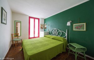 Double bedroom with green decorations
